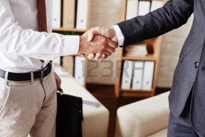 43007955-businessmen-handshaking-after-signing-contract