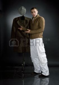 6843970-young-man-in-a-brown-jacket-and-white-trousers