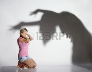 10800362-young-beautiful-woman-frightened-by-the-shadow